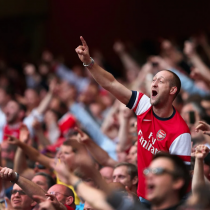 Arsenal fans cheering at the match
